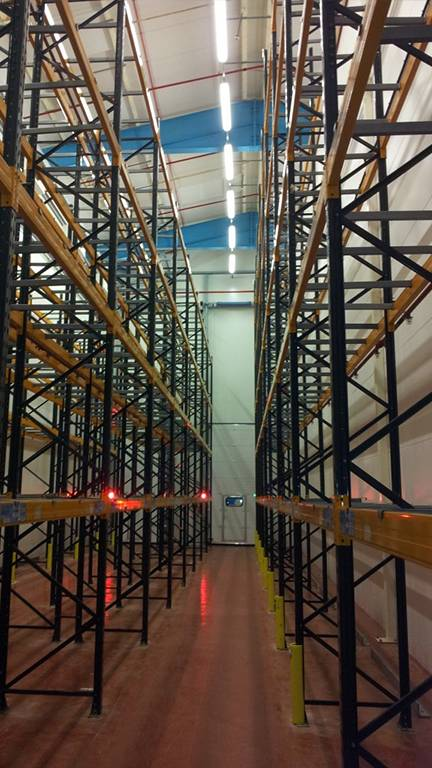 empty cold storage shelves in warehouse