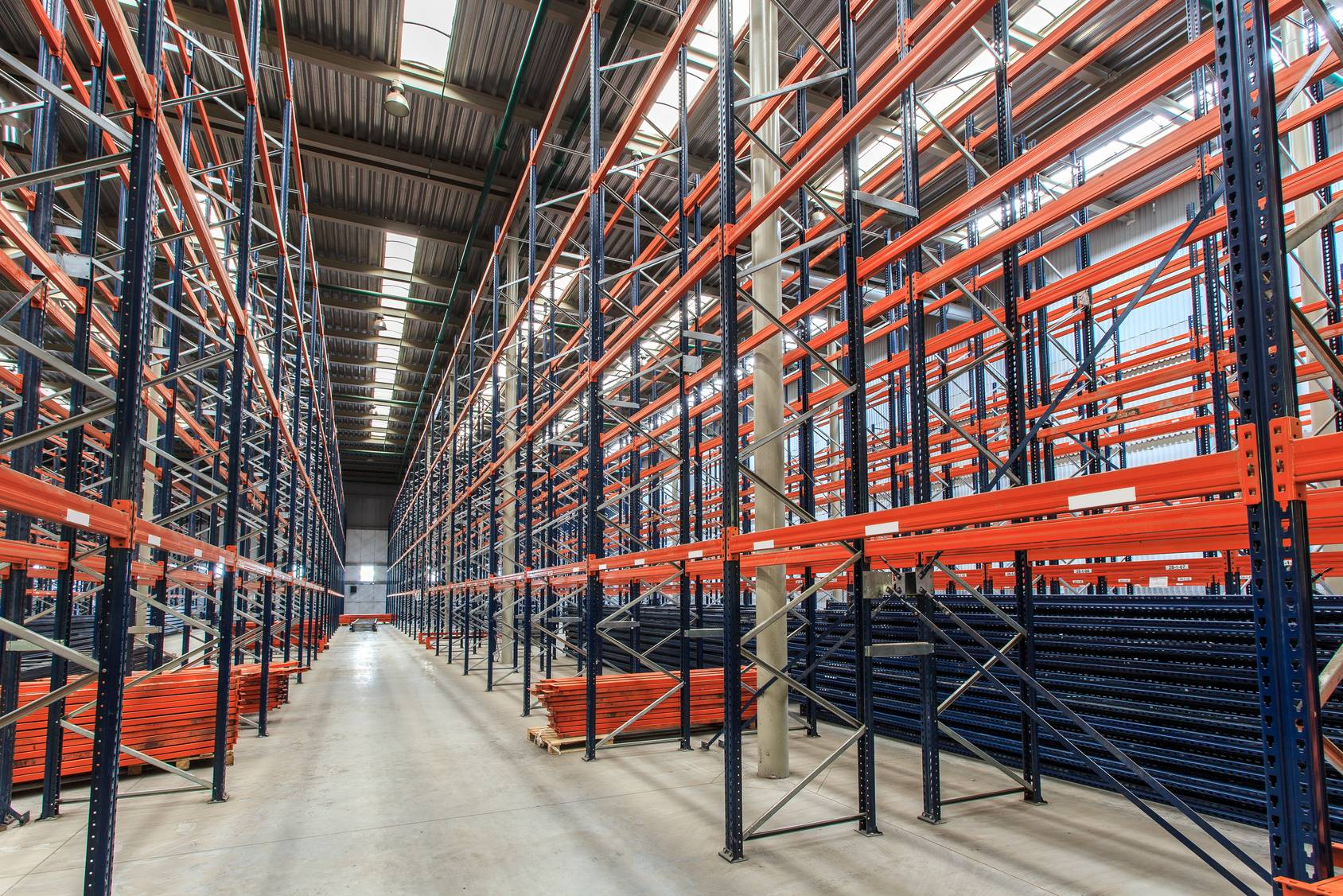 Large warehouse with modular empty shelves