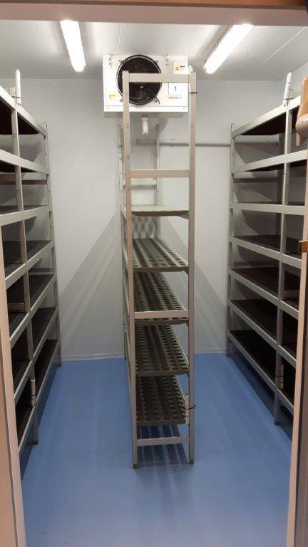 empty shelves of small storage room